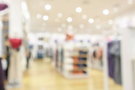 modern clothing store interior blur abstract defocused background with bokeh light Standard-Bild