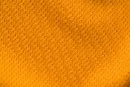 Orange color sports clothing fabric jersey football shirt texture top view Stock Photo