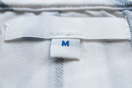 White clothes label close up on new shirt