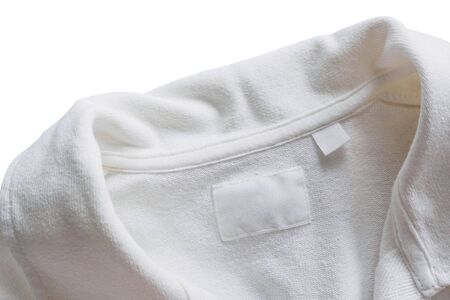 Blank white clothes label on new cotton shirt background