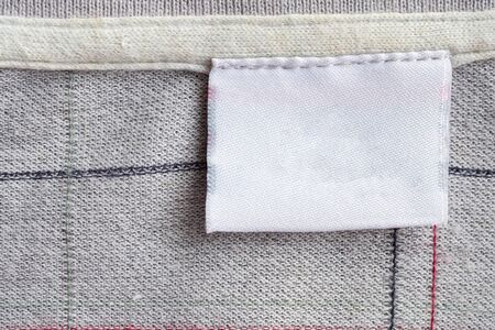 laundry care clothing label on fabric texture
