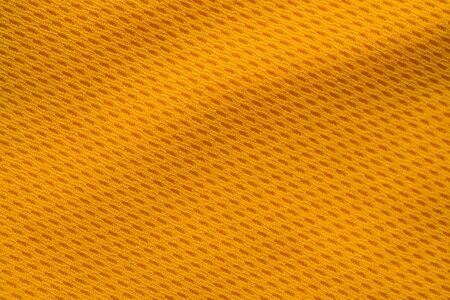 Orange color sports clothing fabric jersey football shirt texture top view Banco de Imagens