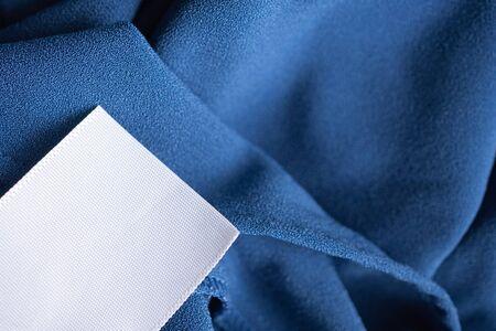 laundry care clothing label on blue dress Stock fotó