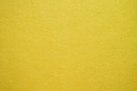 Abstract yellow fabric texture background Banco de Imagens