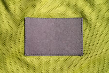laundry care clothing label patch on polyester fabric jersey sport texture