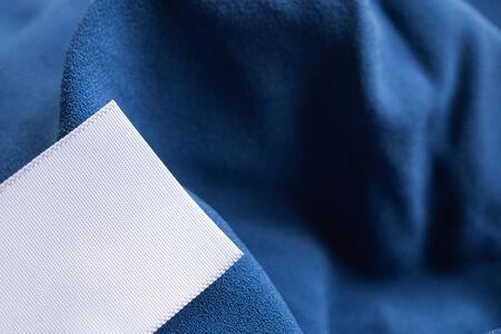 laundry care clothing label on blue dress Stockfoto
