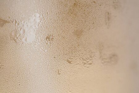 Condensation water drops on drinking glass