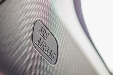 Safety side curtain airbag sign in new modern car Stock Photo