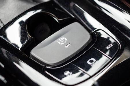 electronic handbrake button in luxury modern car Stock Photo