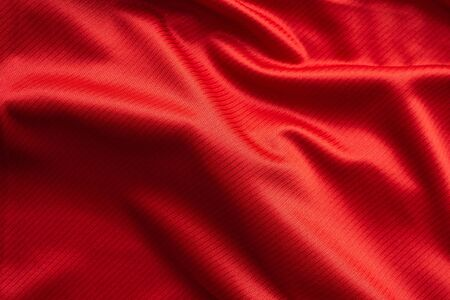 Red sports clothing fabric football jersey texture close up