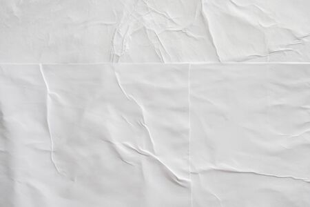 Blank white crumpled and creased paper poster texture background