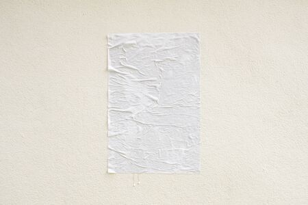 Blank white crumpled and creased adhesive street poster mockup on concrete wall background 写真素材