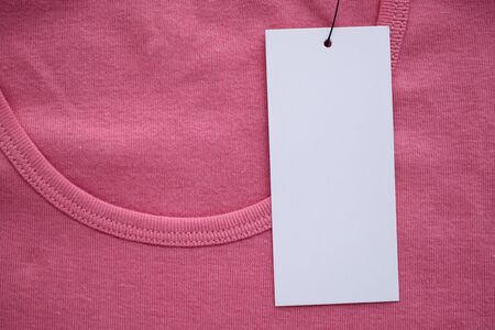 Blank white clothes tag label on new shirt
