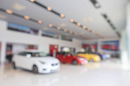 new cars in showroom blurred defocused background Zdjęcie Seryjne
