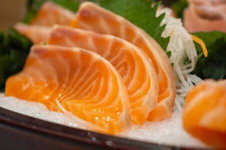 Raw salmon sashimi slice on ice Japanese food 스톡 콘텐츠