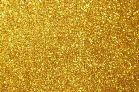 Fond clair de bokeh d'éclat de paillettes d'or abstrait