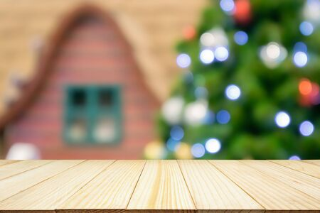 Empty wood table top with Abstract blur Christmas tree with decoration bokeh light background for product display Zdjęcie Seryjne