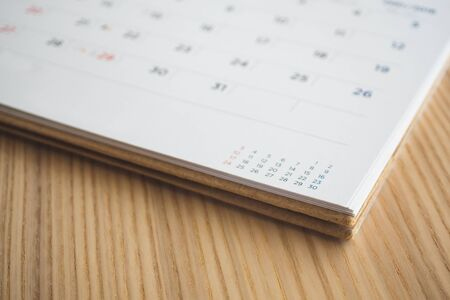 calendar page on wood table background 스톡 콘텐츠