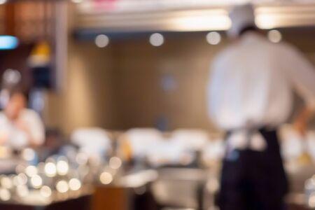 Chef cooking in restaurant kitchen abstract blurred defocused background Zdjęcie Seryjne