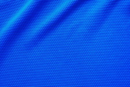 Blue football jersey clothing fabric texture sports wear background, close up top view