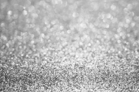 Abstract blur silver glitter sparkle defocused bokeh light background Zdjęcie Seryjne