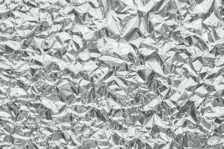 Shiny metal silver gray foil crumpled texture background Stock fotó