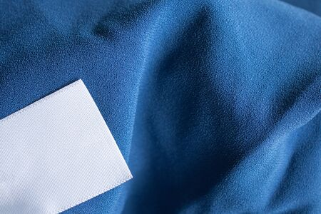 laundry care clothing label on blue dress 版權商用圖片