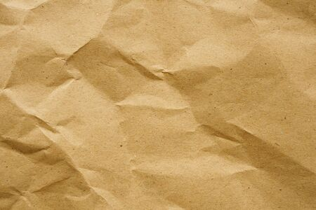 Brown crumpled paper recycled kraft sheet texture background Reklamní fotografie