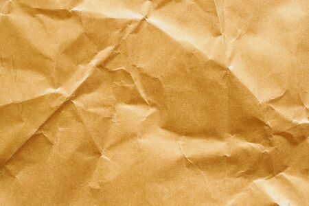 Brown crumpled paper recycled kraft sheet texture background Imagens