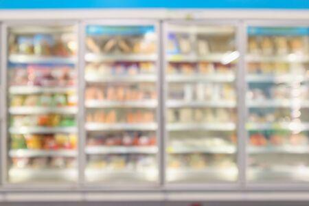 supermarket commercial refrigerators freezer showing frozen foods abstract blur background