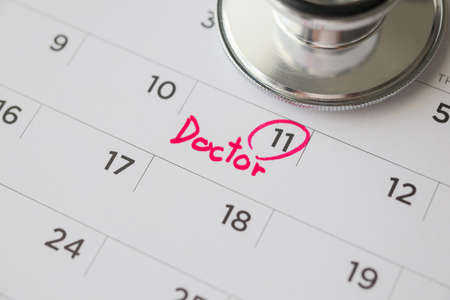 Stethoscope with calendar page date background doctor appointment medical concept
