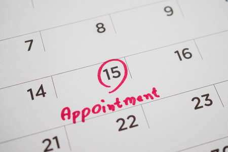 important appointment schedule write on white calendar page date close up Stock Photo