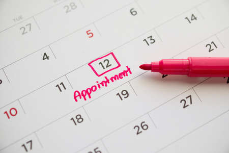 important appointment schedule write on white calendar page date close up Foto de archivo