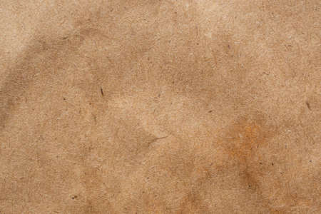 Brown crumpled paper recycled kraft sheet texture background 免版税图像