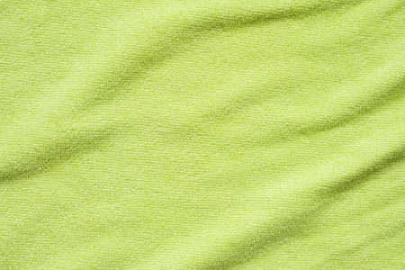 Green towel fabric texture surface close up background 免版税图像
