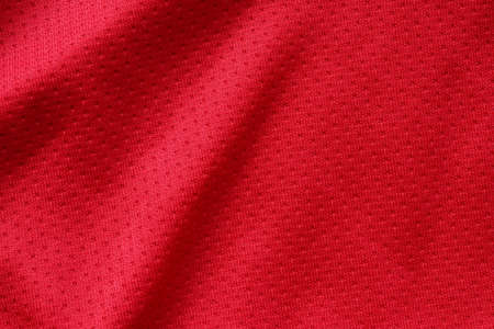 Red sports clothing fabric football shirt jersey texture close up
