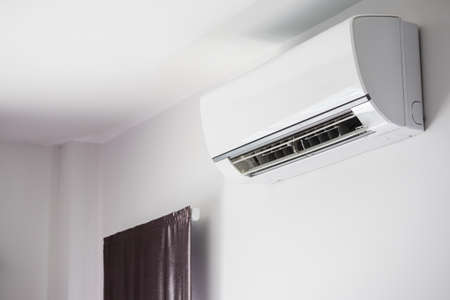 Air conditioner on white wall room interior background