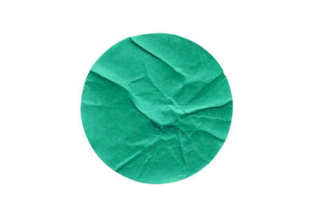 Blank green round adhesive paper sticker label isolated on white background Фото со стока