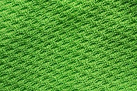 Green sports clothing fabric football shirt jersey texture close up Stock Photo