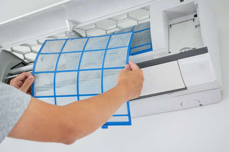 man hand hold air conditioner filter cleaning concept Reklamní fotografie