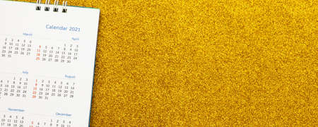 Happy new year 2021 calendar page close up on gold glitter sparkle background