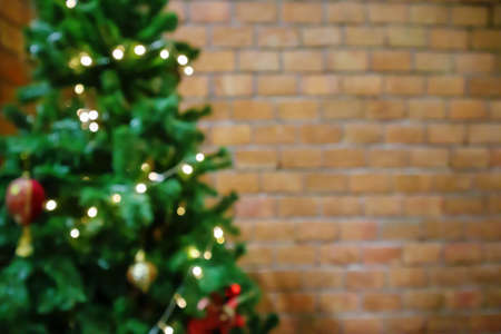 Abstract blur decorated Christmas tree with baubles New Year holidays background