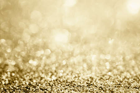 Abstract gold glitter sparkle blurred with bokeh background