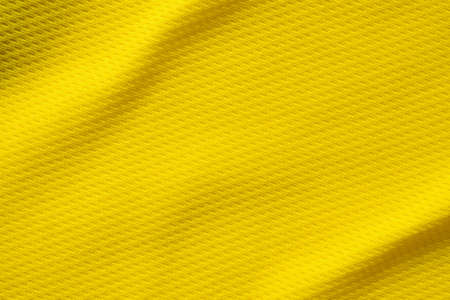 Yellow sports clothing fabric football shirt jersey texture close up Zdjęcie Seryjne