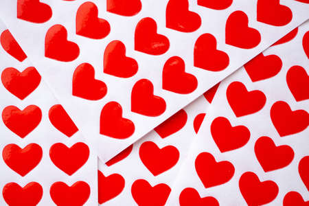 Close up red heart sticker on white paper