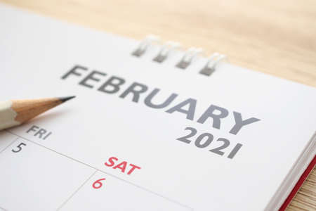 February month on 2021 calendar page with pencil business planning appointment meeting concept