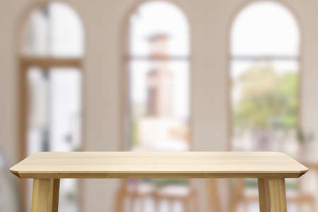 Empty wood table top with cafe restaurant interior blur background