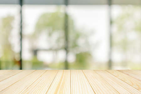 Empty wood table top with blurred window background for product display Standard-Bild