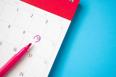 important appointment schedule write on white calendar page date on blue background
