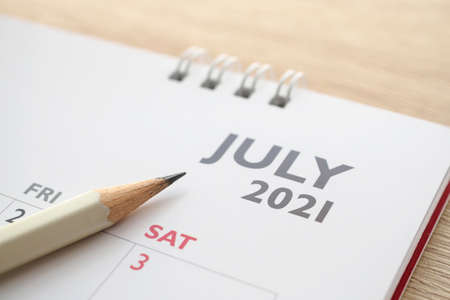 July month on 2021 calendar page with pencil business planning appointment meeting concept